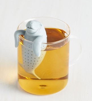 cheerful little manatee sticks to the side of your cup and acts as a tea infuser